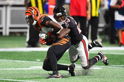 A.J. Green #18 of the Cincinnati Bengals is tackled by Robert Alford #23 of the Atlanta Falcons during the second quarter at Mercedes-Benz Stadium on September 30, 2018 in Atlanta, Georgia.