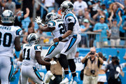 C.J. Anderson #20 celebrates with teammate Cam Newton #1 of the Carolina Panthers after a second quarter touchdown against the Cincinnati Bengals during their game at Bank of America Stadium on September 23, 2018 in Charlotte, North Carolina.