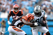 Ian Thomas #80 of the Carolina Panthers runs the ball against Shawn Williams #36 of the Cincinnati Bengals in the second quarter during their game at Bank of America Stadium on September 23, 2018 in Charlotte, North Carolina.
