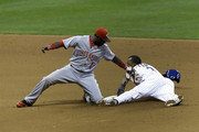 Jean Segura #9 of the Milwaukee Brewers beats the throw to Brandon Phillips #4 of the Cincinnati Reds while stealing second base during the bottom of the seventh inning at Miller Park on September 13, 2013 in Milwaukee, Wisconsin.