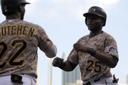 Gregory Polanco #25 of the Pittsburgh Pirates celebrates with Andrew McCutchen #22 after scoring on a RBI single in the first inning during the game against the Cincinnati Reds at PNC Park on May 7, 2015 in Pittsburgh, Pennsylvania.