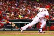 Matt Holliday #7 of the St. Louis Cardinals hits a single against the Cincinnati Reds in the seventh inning at Busch Stadium on April 17, 2015 in St. Louis, Missouri.