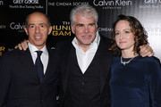 """(L-R) Producer Jon Kilik, Director Gary Ross and Producer Nina Jacobon attend the Cinema Society & Calvin Klein Collection screening of """"The Hunger Games"""" at SVA Theatre on March 20, 2012 in New York City."""