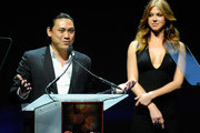 """Director Jon M. Chu (L) and actress Adrianne Palicki promote their upcoming movie, """"G.I. Joe: Retaliation"""" at a Paramount Pictures and DreamWorks Animation event at The Colosseum at Caesars Palace during the opening night of CinemaCon, the official convention of the National Association of Theatre Owners, April 23, 2012 in Las Vegas, Nevada."""