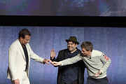 """(L-R) Actors Will Arnett, Dan Fogler and Eddie Redmayne speak onstage during CinemaCon 2018 Warner Bros. Pictures Invites You to """"The Big Picture"""", an Exclusive Presentation of our Upcoming Slate at The Colosseum at Caesars Palace during CinemaCon, the official convention of the National Association of Theatre Owners, on April 24, 2018 in Las Vegas, Nevada."""