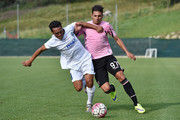 Giuseppe Pezzella (R) of Palermo and Santos of Pontisola compete for the ball during the preseason friendly match between US Citta di Palermo and Pontisola on July 31, 2015 in Ponte di Legno near Edolo, Italy.
