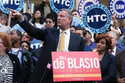Democratic mayoral nominee Bill de Blasio (C) speaks as Christine Quinn (R), New York City Council Speaker and former mayoral hopeful, stands by at a news conference where Quinn endorsed de Blasio outside City Hall on September 17, 2013 in New York City. De Blasio will face Republican Joseph Lhota in the general mayoral election November 5, 2013, with the winner succeeding current Mayor Michael Bloomberg.