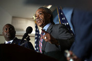 The Rev. Al Sharpton joins with members of the Leadership Conference on Civil and Human Rights during a press conference at the National Press Club June 26, 2012 in Washington, DC. The group met to denounce the expected vote this week in the U.S. House of Representatives on holding Attorney General Eric Holder in contempt of Congress.