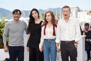 """(L-R) Actresses Isabelle Huppert, Kim Minhee,  Director Hong SangSoo and a guest attend the """"Claire's Camera (Keul-Le-Eo-Ui-Ka-Me-La)"""" photocall during the 70th annual Cannes Film Festival at Palais des Festivals on May 21, 2017 in Cannes, France."""