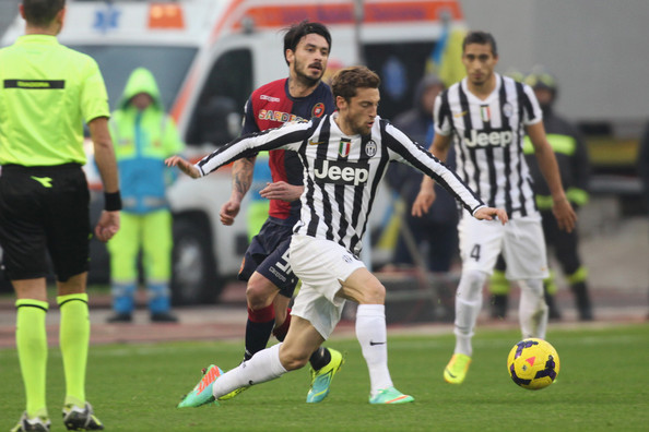 Claudio Marchisio Marchisio Claudio of Juventus and Mauricio Pinilla of Cagliari battle for the ball during the Serie A match between Cagliari Calcio and Juventus at Stadio Sant'Elia on January 12, 2014 in Cagliari, Italy.