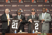 Cleveland Browns draft picks Justin Gilbert #21 and Johnny Manziel #2 are introduced by general manager Ray Farmer (L) and head coach Mike Pettine (R) during a press conference at the Browns training facility on May 9, 2014 in Cleveland, Ohio. Gilbert and Manziel were selected 8th and 22nd, respectively, in the first round.