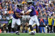 Quarterback Joe Flacco #5 of the Baltimore Ravens hands off to running back Justin Forsett #29 in the first quarter of a game against the Cleveland Browns at M&T Bank Stadium on December 28, 2014 in Baltimore, Maryland.