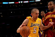 Steve Blake #5 of the Los Angeles Lakers drives against Mo Willimas #2 of the Cleveland Cavaliers at Staples Center on January 11, 2011 in Los Angeles, California.  The Lakers won 112-57.  NOTE TO USER: User expressly acknowledges and agrees that, by downloading and or using this photograph, User is consenting to the terms and conditions of the Getty Images License Agreement.