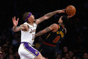 Michael Beasley #11 of the Los Angeles Lakers defends against Jordan Clarkson #8 of the Cleveland Cavaliers during the first half of a game at Staples Center on January 13, 2019 in Los Angeles, California.  NOTE TO USER: User expressly acknowledges and agrees that, by downloading and or using this photograph, User is consenting to the terms and conditions of the Getty Images License Agreement.