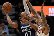 Cedi Osman #16 and Jordan Clarkson #8 of the Cleveland Cavaliers defend against Taj Gibson #67 of the Minnesota Timberwolves during the second quarter of the game on October 19, 2018 at the Target Center in Minneapolis, Minnesota. NOTE TO USER: User expressly acknowledges and agrees that, by downloading and or using this Photograph, user is consenting to the terms and conditions of the Getty Images License Agreement.