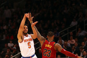 Courtney Lee #5 of the New York Knicks shoots against LeBron James #23 of the Cleveland Cavaliers in the fourth quarter at Madison Square Garden on April 9, 2018 in New York City. NOTE TO USER: User expressly acknowledges and agrees that, by downloading and or using this photograph, User is consenting to the terms and conditions of the Getty Images License Agreement.