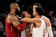 LeBron James #23 of the Cleveland Cavaliers and Enes Kanter #00 of the New York Knicks exchange words as teammates Channing Frye #8 of the Cavaliers and Courtney Lee #5 of the New York Knicks try and separate them at Madison Square Garden on November 13, 2017 in New York City. NOTE TO USER: User expressly acknowledges and agrees that, by downloading and or using this Photograph, user is consenting to the terms and conditions of the Getty Images License Agreement