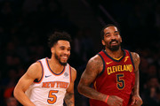 Courtney Lee #5 of the New York Knicks and JR Smith #5 of the Cleveland Cavaliers react after a play in the first half at Madison Square Garden on April 9, 2018 in New York City. NOTE TO USER: User expressly acknowledges and agrees that, by downloading and or using this photograph, User is consenting to the terms and conditions of the Getty Images License Agreement.