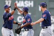 Michael Brantley #23, Michael Bourn #24, and David Murphy #7 of the Cleveland Indians celebrate after defeating the Boston Red Sox, 3-2, at Fenway Park on June 14, 2014 in Boston, Massachusetts.