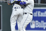 Salvador Perez (R) of the Kansas City Royals celebrates his walk-off RBI single with Alex Gordon #4 in the 10th inning against the Cleveland Indians at Kauffman Stadium on September 27, 2018 in Kansas City, Missouri. The Royals won 2-1.