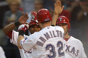 Josh Hamilton #32 of the Texas Rangers celebrates a grand slam with Elvis Andrus and Ian Kinsler against the Cleveland Indians at Rangers Ballpark in Arlington on September 14, 2011 in Arlington, Texas.