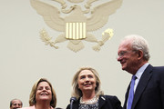 """U.S. Secretary of State Hillary Clinton (C) stands with committee chairman U.S. Rep. Ileana Ros-Lehtinen (R-FL) (L) and ranking member U.S. Rep. Howard Berman (D-CA) (R) prior to a hearing before the House Foreign Affairs Committee October 27, 2011 on Capitol Hill in Washington, DC. Clinton testified on """"Afghanistan and Pakistan: Transition and the Way Forward."""""""