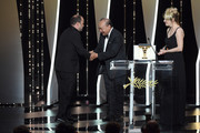 """President of the Camera d'or jury Rithy Panh and Valeria Bruni Tedeschi present Cesar Diaz with the Camera d'Or award for the film """"Nuestras Madres"""" at the Closing Ceremony during the 72nd annual Cannes Film Festival on May 25, 2019 in Cannes, France."""