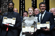 """(L-R) Jury Price for """"Les Miserables"""", Ladj Ly, Best Actress for her role in """"Little Joe"""", Emily Beecham and Best Actor for his role in """"Dolor y Gloria"""", Antonio Banderas pose on stage during the Closing Ceremony of the 72nd annual Cannes Film Festival on May 25, 2019 in Cannes, France."""