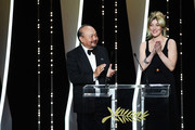 President of the Camera d'or jury Rithy Panh and Valeria Bruni Tedeschi present the Camera d'Or award at the Closing Ceremony during the 72nd annual Cannes Film Festival on May 25, 2019 in Cannes, France.