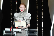 Emily Beecham receives the Best Actress award for her role in Little Joe at the Closing Ceremony during the 72nd annual Cannes Film Festival on May 25, 2019 in Cannes, France.