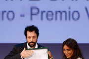 Jury president Haifaa Al Mansour (R) presents on stage to filmmaker Noaz Deshe the Lion of the Future Award he received for his movie 'White Shadow' during the Closing Ceremony of the 70th Venice International Film Festival at the Palazzo del Cinema on September 7, 2013 in Venice, Italy.