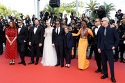 """(L-R) Jury Members Alice Rohrwacher, Pawel Pawlikowski, Yorgos Lanthimos, Elle Fanning, Alejandro Gonzalez Inarritu, Kelly Reichardt, Maimouna N'Diaye, Enki Bilal and Robin Campillo attend the closing ceremony screening of """"The Specials"""" during the 72nd annual Cannes Film Festival on May 25, 2019 in Cannes, France."""