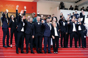 """First Row (L-R): Reda Kateb, Eric Toledano, Vincent Cassel and Olivier Nakache and actors from """"The Specials"""" attend the closing ceremony screening of """"The Specials"""" during the 72nd annual Cannes Film Festival on May 25, 2019 in Cannes, France."""