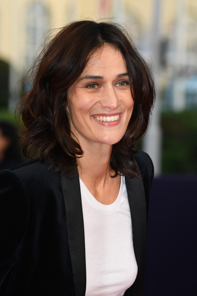 'Line Of Fire' Premiere - 44th Deauville American Film Festival [line of fire,hair,hairstyle,white-collar worker,businessperson,layered hair,smile,official,long hair,brown hair,clotilde hesme,deauville,france,deauville american film festival,film premiere]