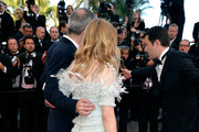 (L-R) Actress Chloe Grace Moretz and director Olivier Assayas attend the 'Clouds Of Sils Maria' premiere during the 67th Annual Cannes Film Festival on May 23, 2014 in Cannes, France.
