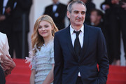 "Actress Chloe Grace Moretz and director Olivier Assayas attend the ""Clouds Of Sils Maria"" premiere during the 67th Annual Cannes Film Festival on May 23, 2014 in Cannes, France."