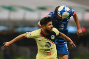 Oribe Peralta (L) of America struggles for the ball against Jose Basanta (R) of Monterrey during the fourth round match between Club America and Monterrey as part of the Torneo Apertura 2018 Liga MX at Azteca Stadium on August 11, 2018 in Mexico City, Mexico.
