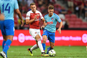 Luciano Vietto #17 of Atletico Madrid and Aaron Ramsey #8 of Arsenal competes for the ball during the International Champions Cup 2018 match between Club Atletico de Madrid and Arsenal at the National Stadium on July 26, 2018 in Singapore.