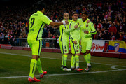 Neymar JR. (R) celebrates scoring their third goal with team mates Lionel Messi (2ndR), Andres Iniesta (3dR) and Luis Suarez (L) during the Copa del Rey Round of 8 second leg match between Club Atletico de Madrid and FC Barcelona at Vicente Calderon Stadium on January 28, 2015 in Madrid, Spain.
