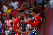 Koke of Atletico Madrid celebrates after scoring his team's third goal with teammate Antoine Griezmann during the Group A match of the UEFA Champions League between Club Atletico de Madrid and Club Brugge at Estadio Wanda Metropolitano on October 3, 2018 in Madrid, Spain.