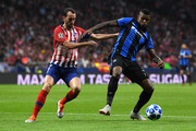 Wesley of Club Brugge is challanged by Diego Godin of Atletico Madrid during the Group A match of the UEFA Champions League between Club Atletico de Madrid and Club Brugge at Estadio Wanda Metropolitano on October 3, 2018 in Madrid, Spain.