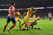 Lionel Messi of FC Barcelona battles with Koke of Atletico Madrid during the Liga match between Club Atletico de Madrid and FC Barcelona at Wanda Metropolitano on December 01, 2019 in Madrid, Spain.