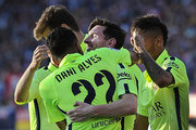 Lionel Messi of FC Barcelona celebrates with Dani Alves after scoring his team's opening goal during the La Liga match between Club Atletico de Madrid and FC Barcelona at Vicente Calderon Stadium on May 17, 2015 in Madrid, Spain.