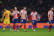 Saul Niguez, Vitolo, Thomas Lemar and Koke of Atletico Madrid look dejected in defeat after the Liga match between Club Atletico de Madrid and FC Barcelona at Wanda Metropolitano on December 01, 2019 in Madrid, Spain.
