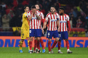 Vitolo, Saul Niguez, Koke and Thomas Lemar of Atletico Madrid react in defeat after the Liga match between Club Atletico de Madrid and FC Barcelona at Wanda Metropolitano on December 01, 2019 in Madrid, Spain.