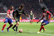 Paulo Dybala of Juventus is challenged by Koke and Thomas Partey of Atletico Madrid during the UEFA Champions League Round of 16 First Leg match between Club Atletico de Madrid and Juventus at Estadio Wanda Metropolitano on February 20, 2019 in Madrid, Spain.