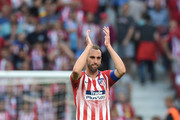 Diego Godin of Atletico Madrid applauds the public after his last home match for the club at the end of the La Liga match between  Club Atletico de Madrid and Sevilla FC at Wanda Metropolitano on May 12, 2019 in Madrid, Spain.