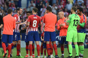 Atletico Madrid players applaud Diego Godin after his last home match for the club at the end of the La Liga match between  Club Atletico de Madrid and Sevilla FC at Wanda Metropolitano on May 12, 2019 in Madrid, Spain.