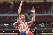 Diego Godin of Atletico Madrid is thrown into the air by his teammates during celebrations after his last home match for the club  at the end of the La Liga match between  Club Atletico de Madrid and Sevilla FC at Wanda Metropolitano on May 12, 2019 in Madrid, Spain.