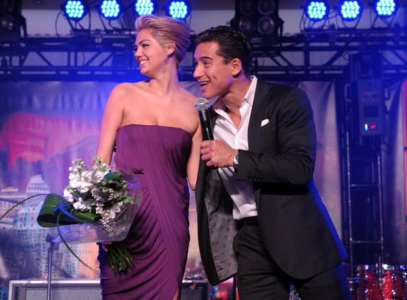 She takes the stage with Mario Lopez.